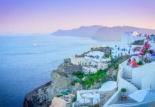 The Travel Speak - Top Things To Do In Santorini - Visit Oia Village